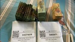 Khởi tố nhóm đối tượng chiếm đoạt tài sản qua việc cấp thẻ luồng xanh
