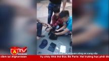 Bắt đối tượng vận chuyển 2 bánh heroin tại Hà Nội