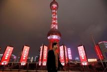Người Trung Quốc trở lại đi làm giữa những thành phố 'hôn mê' vì virus corona