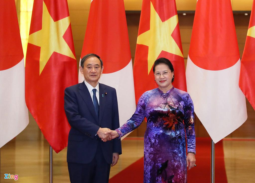 Nhìn lại một ngày hoạt động của Thủ tướng Nhật tại Hà Nội - Ảnh 11.