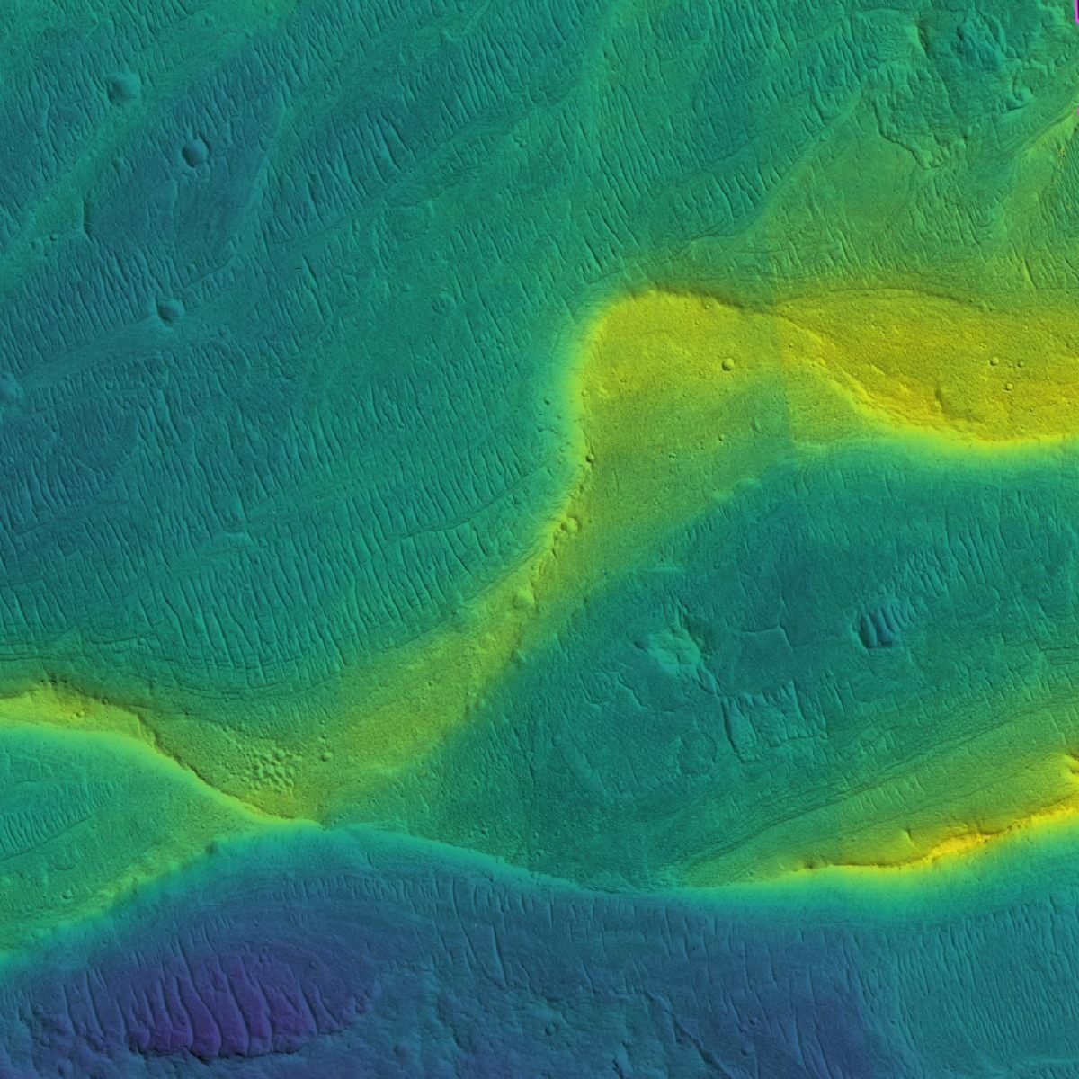 Hình ảnh dấu tích của lòng sông trên sao Hỏa được vệ tinh quỹ đạo chụp lại với các màu sắc cho thấy sự khác nhau về độ cao. Màu xanh là ở mức thấp và màu vàng là ở mức cao.