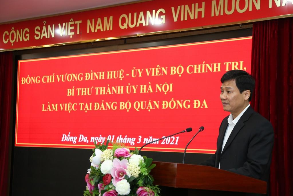 Phó Bí thư Thường trực Quận uỷ, Chủ tịch HĐND quận Đống Đa Nguyễn Anh Cường báo cáo tại buổi làm việc