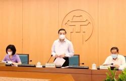 Tập thể UBND TP Hà Nội xem xét một số nội dung trình kỳ họp giữa năm của HĐND TP