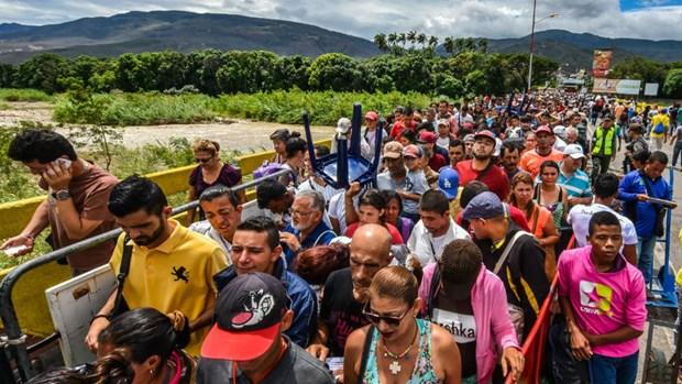 lhq can 135 ty usd de doi pho voi dong nguoi ti nan venezuela